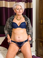 Blonde MILF takes off leopard blouse and shows her sexy mature body