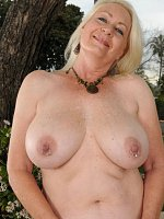 Busty blonde granny shows her mature ass in the garden