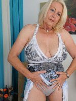 Blonde grandma with big pierced boobs shows ass doggy-style