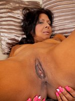 Exotic MILF puts a toy into her sweet shaved pussy