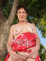 Brunette grandma Anna D gets naked outdoors