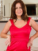 Sexy brunette MILF Carol Foxwell gets naked in front of fireplace