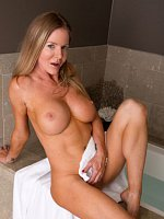 Busty MILF Amber Michaels naked in the bathroom