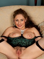 Beautiful MILF in fishnet stockings shows her amazing ass on a couch