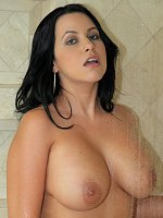 Busty brunette MILF gets naked and takes shower