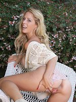 Busty blonde MILF with lovely tight ass shows it on a bench in the garden