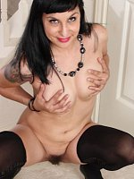 Hairy MILF Penelope Patterson in only black stockings.