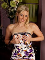 Mature blonde Sophie Kay wearing only purple stockings.