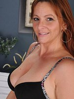 Gorgeous redhead MILF Gia Sophia drops her panties.