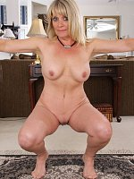 Blond housewife Aubrey Adams naked in the office.