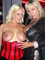 Mrs. Siren and Naughty Alysha have some fun with each other while at a nightclub.