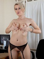 Office MILF Evey Kristal masturbating at her desk.