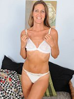 LA ValkenbergBlonde 50 year old LA Valkenberg spreading her pussy wide in here