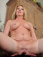 Summer Sands	Sexy 53 year old Summer Sands slips off her slinky black lingerie