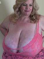 The fantastic Suzie 44K is back! She is in her sexy lingerie where her big tits can barely fit. She