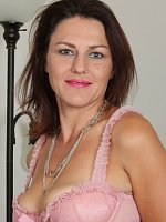 Joana Jakes - 41 year old and cute Joana Jakes slides out of her pink lingerie here