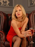 Sexy blondy in sexy red dress gets horny after a glass of wine
