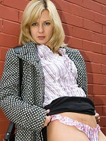 Blonde Laurita shows ass in public places