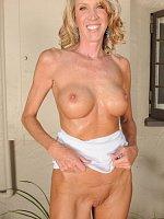 Brynn Hunter, Busty blonde Brinn Hunter slips off her denim skirt and spreads wide