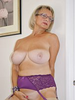 Gorgeous busty MILF with sexy tan lines shows her curvy body in the office