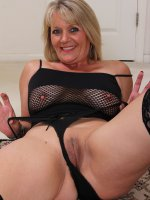 Sherri Donovan, Naughty blonde 48 year old Sherri Donovan in fishnet lingerie posing