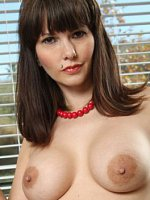Mature sexpot Carrie shows off her perfect pussy piercing.