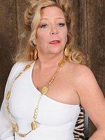 Karen Summer - Golden girl of porn Karen Summer slips out of her white elegant dress