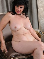 Raven Flight - 58 year old housewife Raven Flight opens her mature legs and pussy