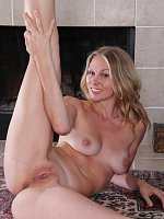 Lara Elaine - During yoga stretches Lara Elaine gets naked and stretches pussy