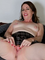 Molly Golly - Cute 41 year old Molly Golly gets naked on the trampoline in here